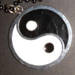 Adviesgroep Koi en vijver - NEt als Ying-Yang moet je voerbeleid in balans zijn